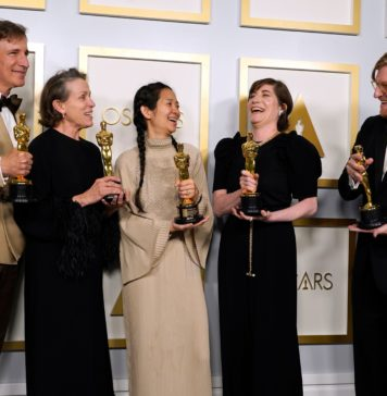 """Producers Peter Spears (from left), Frances McDormand, Chloe Zhao, Mollye Asher and Dan Janvey, winners of the award for best picture for """"Nomadland"""" at the Oscars 93rd Annual Academy Awards"""